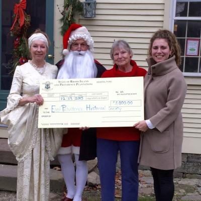 Receiving $5,000 check from East Prov rep Karherine Kazarian